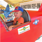 child in aircraft simulator