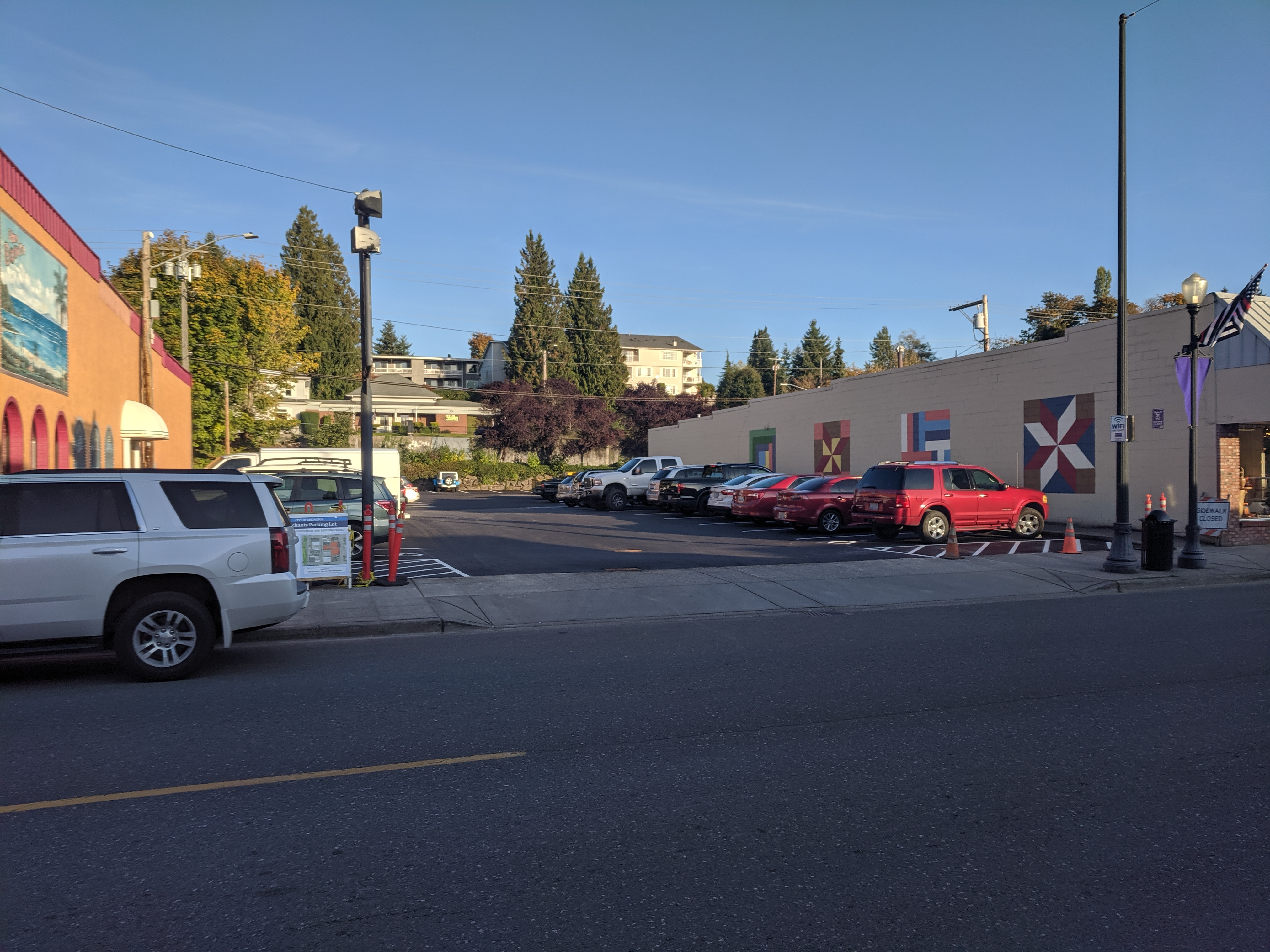 Photo of Merchant Parking Lot with new pavement and parking space striping