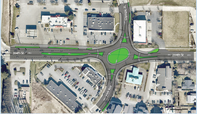 Sketch of oval roundabout in the intersection of 204th St NE and 77th Avenue NE with channelization