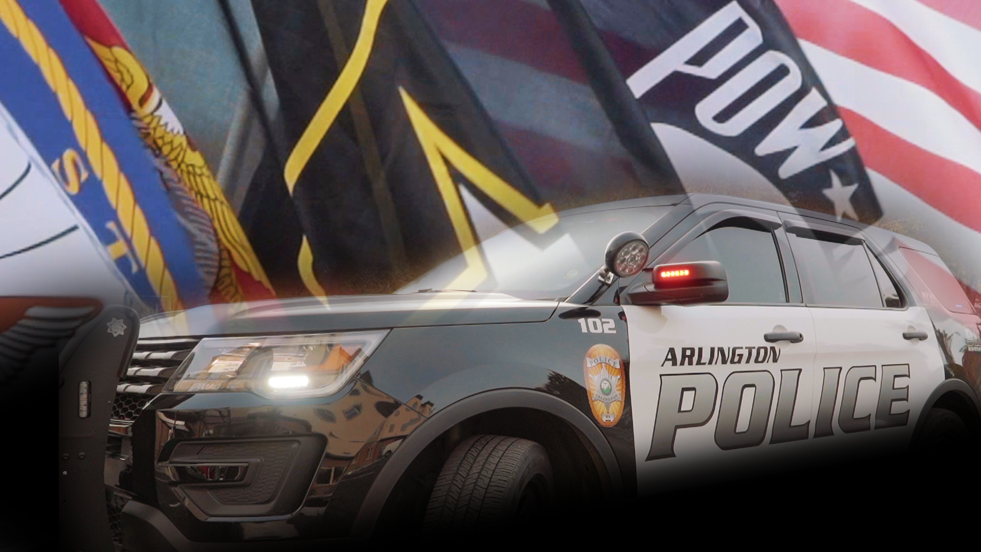 Flags of the branches of the US armed services with an Arlington black and white patrol vehicle